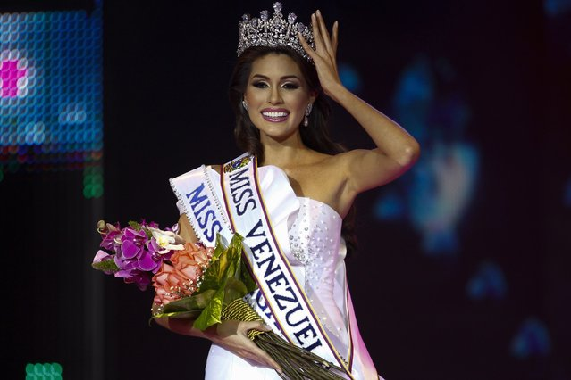 Contestant Maria Isler reacts after she wins the Miss Venezuela 2012 pageant in Caracas August 30, 2012. The winner of the competition will represent Venezuela to participate in the 2013 Miss Universe pageant. (Photo by Carlos Garcia Rawlins/Reuters)