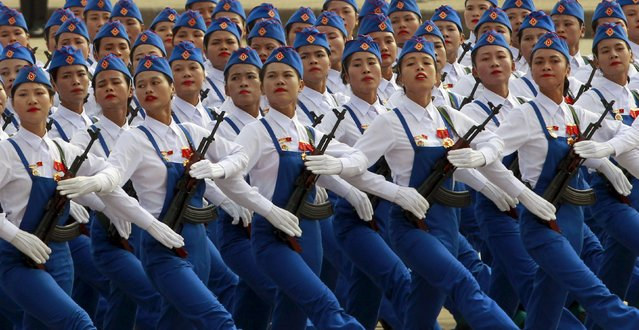 Vietnamese female personnel of self-defence force march during a parade marking their 70th National Day at Ba Dinh square in Hanoi, Vietnam September 2, 2015. (Photo by Reuters/Kham)