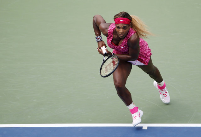 Serena Williams, of the United States, chases down shot against Kaia Kanepi, of Estonia, during the fourth round of the 2014 U.S. Open tennis tournament, Monday, September 1, 2014, in New York. (Photo by Seth Wenig/AP Photo)