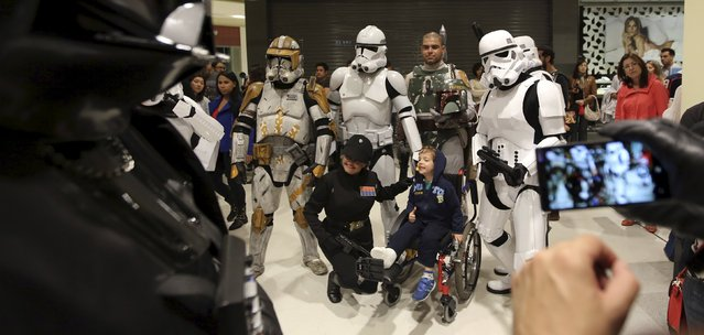 """A customer takes photograph with people dressed with the characters of the """"Star Wars: The Force Awakens"""" on """"Force Friday"""" in Sao Paulo, Brazil, September 4, 2015. (Photo by Paulo Whitaker/Reuters)"""