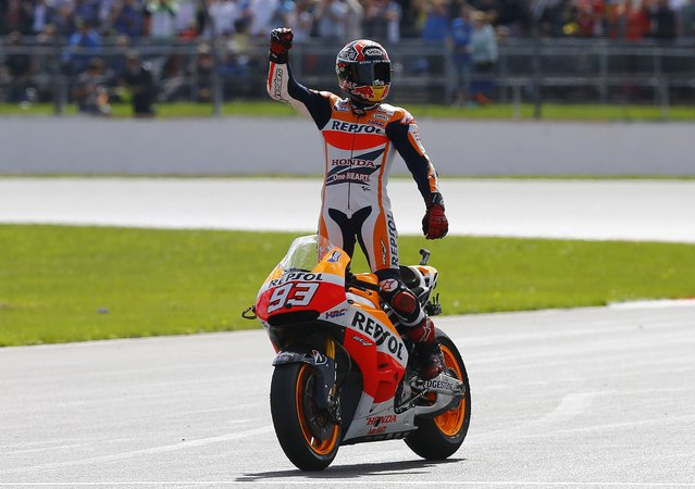 Honda MotoGP rider Marc Marquez of Spain celebrates winning the British Grand Prix at the Silverstone Race Circuit, central England, August 31, 2014. (Photo by Darren Staples/Reuters)