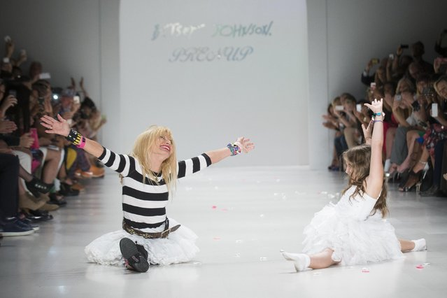Designer Betsy Johnson (L) does a cartwheel split with her granddaughter during the Spring/Summer 2015 Betsey Johnson collection during New York Fashion Week September 10, 2014. (Photo by Brendan McDermid/Reuters)