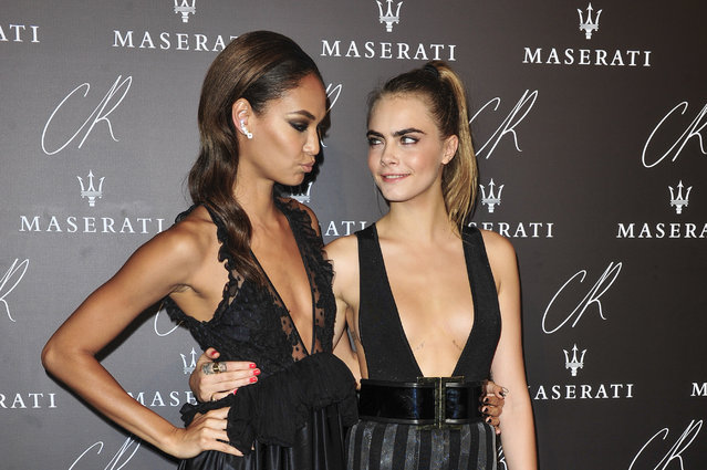 Joan Smalls, left, and Cara Delevingne attend the launch party of the CR Fashion Book N.5 hosted by Carine Roitfeld & Stephen Gan in Paris, Tuesday, September 30, 2014. (Photo by Zacharie Scheurer/AP Photo)