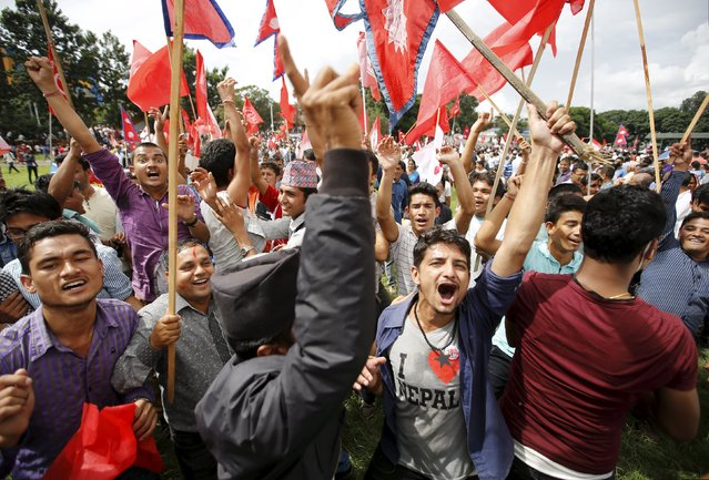People cheer during a celebration a day after the first democratic constitution was announced in Kathmandu, Nepal September 21, 2015. (Photo by Navesh Chitrakar/Reuters)