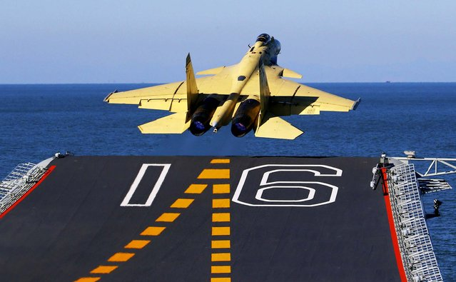 In this undated photo released by China's Xinhua News Agency, made available on Sunday a carrier-borne J-15 fighter jet takes off from China's first aircraft carrier, the Liaoning. China has successfully landed a fighter jet on its first aircraft carrier, which entered service two months ago, the country's official news agency confirmed Sunday. (Photo by Zha Chunming/Xinhua)