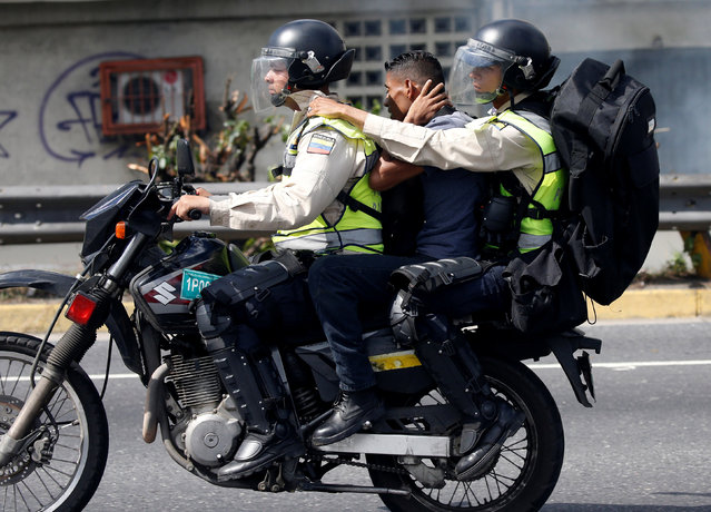 A protester (C) is detained during a rally to demand a referendum to remove Venezuela's President Nicolas Maduro in Caracas, Venezuela, September 1, 2016. (Photo by Carlos Garcia Rawlins/Reuters)