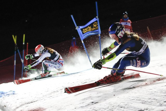 United States' Mikaela Shiffrin, right, and Slovakia's Petra Vlhova compete during the final run of an alpine ski, women's World Cup parallel slalom in Courchevel, France, Wednesday, December 20, 2017. (Photo by Gabriele Facciotti/AP Photo)