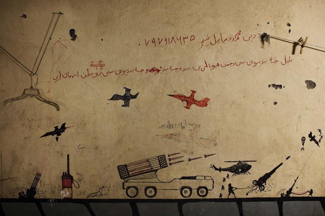 Graffiti left behind by Taliban fighters remains on the walls of a compound now used as a command center for the U.S Marine Corps's First Battalion, Eighth Marines at Musa Qala in Helmand province, Afghanistan November 10, 2010. (Photo by Finbarr O'Reilly/Reuters)