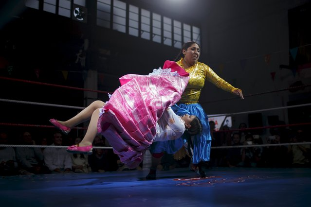 "Bolivian wrestlers Yenny Mamani (R), nicknamed Martha ""La Altena"" and Leonor Cordova, nicknamed Anglea ""La Simpatica"", battle during a wrestling bout in Madrid, Spain, October 8, 2015. (Photo by Juan Medina/Reuters)"
