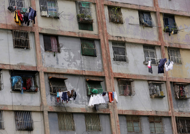 Clothes hang outside the windows of a building to dry in Caracas, Venezuela September 8, 2016. (Photo by Henry Romero/Reuters)