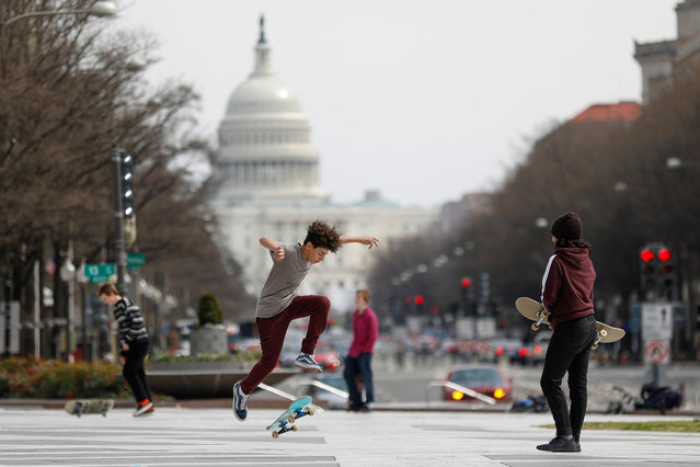 Kids perform skateboard tricks at Freedom Plaza, as Mayor Muriel Bowser declared a State of Emergency due to the coronavirus disease (COVID-19) in Washington, U.S., March 16, 2020. (Photo by Tom Brenner/Reuters)