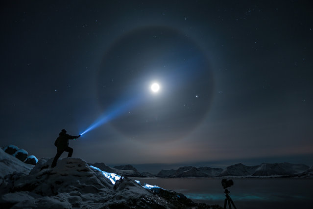 A halo appears around the moon in Kvæfjord, Troms, Norway, on February 19, 2013. Such halos occur when moonlight is refracted by ice crystals in the atmosphere. (Photo by Steve Nilsen/Andre Sørensen)