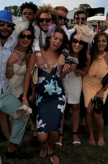 A group of friends getting a little cheeky during Melbourne Cup celebrations, on November 4, 2014. (Photo by Mal Fairclough/Rex Features)