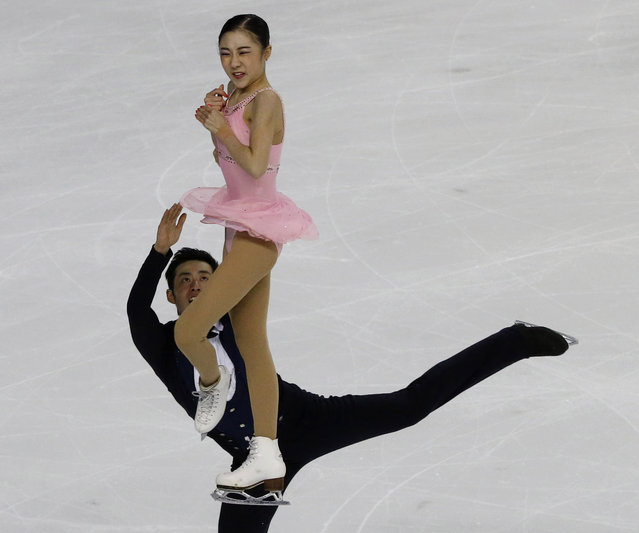 Zuehan Wang and Lei Wang of China, compete in the Pairs Free Skating event, during the ISU figure skating Eric Bompard Trophy at Bordeaux's skating arena, western France, Saturday, November 22, 2014. Ksenia Stolbova and Fedor Klimov of Russia won the pairs competition ahead of Wenjing Sui, Cong Han,  and Zuehan Wang, Lei Wang of China. (Photo by Michel Euler/AP Photo)