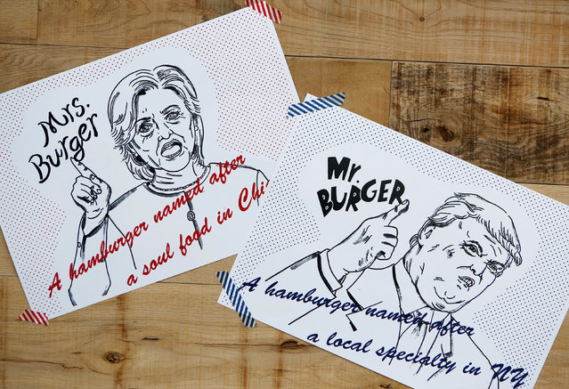 """Campaign posters of Mr. and Mrs. Burger featuring U.S. presidential candidates Hillary Clinton and Donald Trump are displayed at J.S. Burgers Cafe in Tokyo, Japan October 7, 2016. Donald Trump and Hillary Clinton inspired burgers are being served up at a restaurant in Japan ahead of the US Presidential Election. Customers can order their favoured presidential nominee in burger form at J.S Burger Café in Shinjuku, Tokyo. The """"Trump burger"""" includes pastrami, beef patties, coleslaw and a homemade """"Russian"""" dressing housed between a black bun. The inky hue of the burger is claimed to represent the Republican's """"dark side"""".  Clinton's speciality sandwich features a lighter coloured, poppy-seed bun containing two sausages, yellow mustard and pickles. The real life bun fight between the nominees continues to heat up as the November 8 election edges closer. Clinton currently holds a 3.9 point lead against Trump. (Photo by Megumi Lim/Reuters)"""