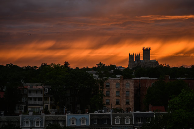 Washington National Cathedral is seen during sunset after a storm this afternoon on Monday, June 19, 2017, in Washington, D.C. (Photo by Salwan Georges/The Washington Post)