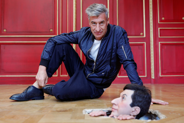 "Italian artist Maurizio Cattelan poses with his creation ""Untitled"" (2001) prior to the opening of the exhibition ""Not Afraid of Love"" at the Hotel de la Monnaie in Paris, France, October 17, 2016. (Photo by Philippe Wojazer/Reuters)"
