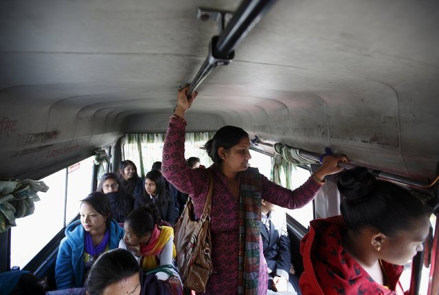 Passengers travel in a women-only bus in Kathmandu January 6, 2015. (Photo by Navesh Chitrakar/Reuters)
