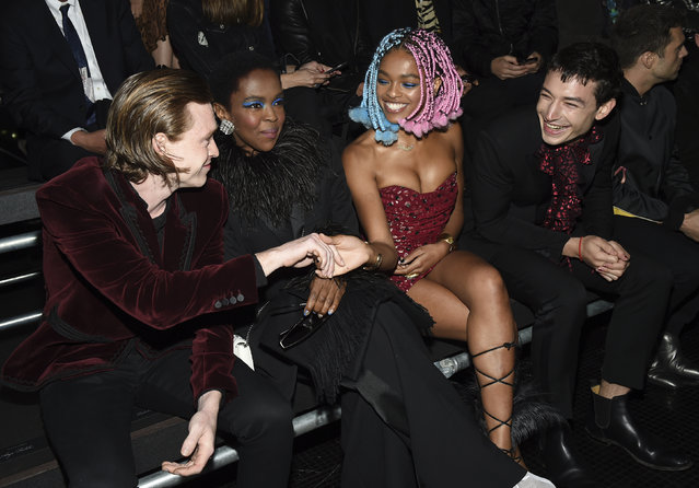 Actor Caleb Landry Jones, singer Lauryn Hill, Selah Marley and actor Ezra Miller, from left, attend the Saint Laurent Spring/Summer 2019 Menswear Collection at Liberty State Park on Wednesday, June 6, 2018, in Jersey City, N.J. (Photo by Evan Agostini/Invision/AP Photo)