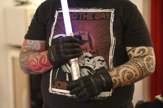 A member of the Sport Saber League with arm tattoos holds his light saber during a training session in Paris, France, November 9, 2015. (Photo by Charles Platiau/Reuters)