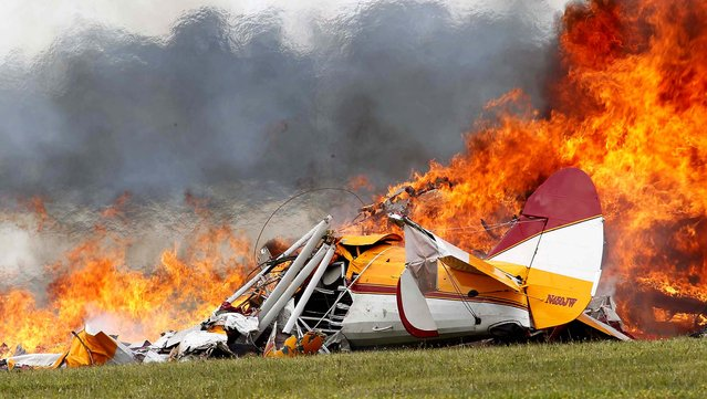 The plane burns after impact. (Photo by Ty Greenlees/Dayton Daily News)