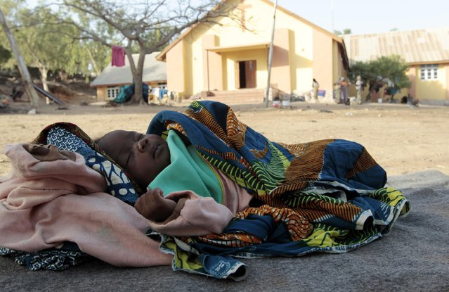 Baby Lurky, whose family was displaced as a result of Boko Haram attacks in the northeast region of Nigeria, sleeps in the shade at a camp for internally displaced people (IDP) in Yola, Adamawa State January 14, 2015. (Photo by Afolabi Sotunde/Reuters)