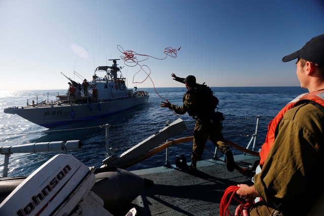 Israeli soldiers take part in a drill simulating the targeting of an infiltrated enemy vessel and the evacuation of a patrol boat, in the Mediterranean Sea off the coast of Ashdod, southern Israel November 8, 2016. (Photo by Amir Cohen/Reuters)