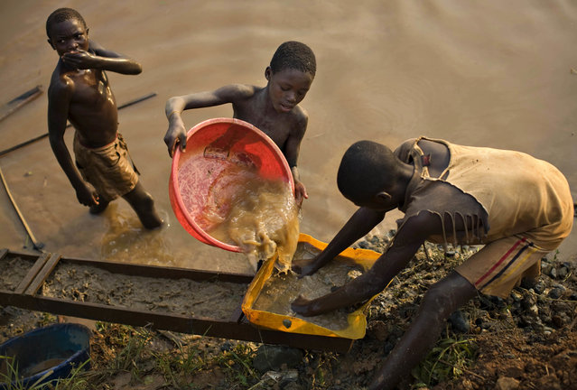 Boys pan for gold on a riverside at Iga Barriere, 25 km (15 miles) from Bunia, in the resource-rich Ituri region of eastern Congo February 16, 2009. Ituri is one of many areas of the country to have experienced bitter ethnic conflict between rival tribes in recent years. Massacres have left tens of thousands dead. It is this fighting that led U.S. authorities to take the unprecedented step of naming Congo in section 1502 of the Dodd-Frank financial regulation act, which says U.S.-listed companies that source gold, tungsten, tantalum and tin from Congo or its neighbours must assure the U.S. stock exchange regulator that their business is not helping fund conflict. (Photo by Finbarr O'Reilly/Reuters)