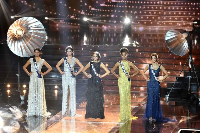 Contestants stand on stage during the Miss France 2016 beauty contest on December 19, 2015 in Lille. (Photo by Philippe Huguen/AFP Photo)