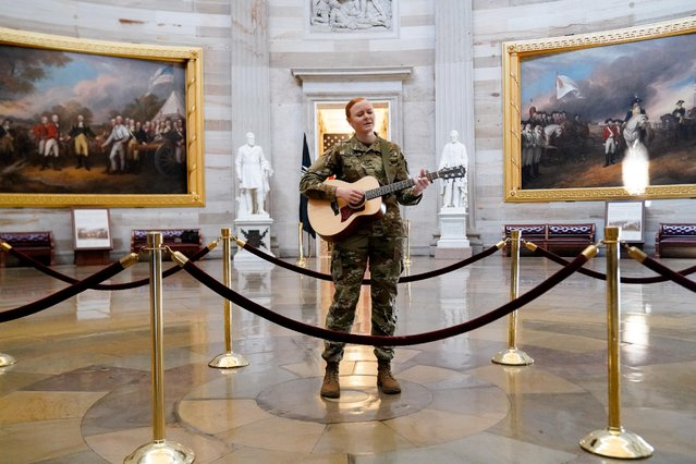 Michigan National Guard member Sgt. Hannah Boulder sings while playing guitar in the U.S. Capitol Rotunda in Washington, U.S., March 10, 2021. (Photo by Erin Scott/Reuters)