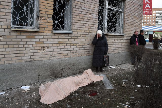 A woman cries near the body of her son, killed during a shelling at the hospital of Donetsk's Tekstilshik district, on Febuary 4, 2015. At least 12 people were killed in fighting between soldiers and pro-Russian separatists in east Ukraine, including four civilians who died when a hospital was hit in rebel stronghold Donetsk today. (Photo by Dominique Faget/AFP Photo)