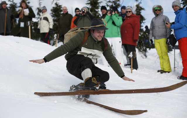"A participant competes in the ""Nostalgic Ski Race"" in the western town of Neuastenberg February 8, 2015. The ""Nostalgic Ski Race"" is held every two years with about 40 participants and is organized by the ski club of Neuastenberg, a town which was founded in 1713. The conditions for the participation in the race are vintage skis and dresses. (Photo by Ina Fassbender/Reuters)"
