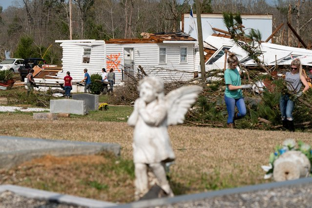 People clean up damage outside Ragan Chapel United Methodist Church the day after a string of tornadoes caused several fatalities in Ohatchee, Alabama, U.S., March 26, 2021. (Photo by Elijah Nouvelage/Reuters)