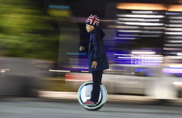 Nine-year-old Rayen Koan rides his Ninebot one-wheel self-balancing scooter, in downtown Los Angeles, California December 30, 2015. (Photo by Robyn Beck/AFP Photo)