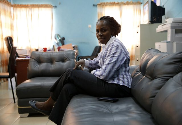 "Associate Professor Abigail Ogwezzy-Ndisika, a Christian from Nigeria's delta region, sits for a portrait in her office at the University of Lagos January 26, 2015. ""The Boko Haram insurgency did not start today. We have already given out a timetable to the whole world (for) the election. Why postpone it now? (Photo by Akintunde Akinleye/Reuters)"