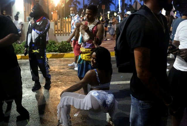 A dance party breaks out just before the 8pm curfew imposed by local authorities, amid the coronavirus disease (COVID-19) pandemic, at South Beach during Spring Break in Miami, Florida, U.S., March 27, 2021. (Photo by Yana Paskova/Reuters)