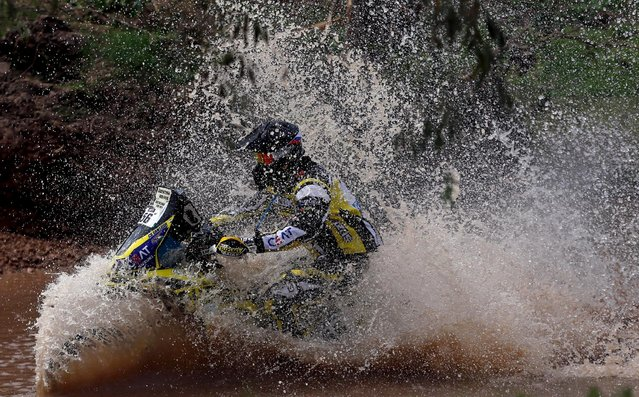 Santosh Shivashankar Chunchunguppe of India rides his Suzuki through the water during the Buenos Aires-Rosario prologue stage of Dakar Rally 2016 in Arrecifes, Argentina, January 2, 2016. (Photo by Marcos Brindicci/Reuters)