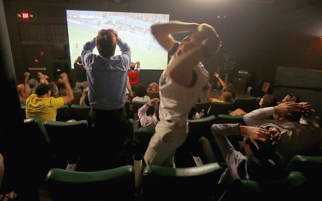 In this July 1, 2014, file photo, fans react during the United States' loss to Belgium in a 2014 World Cup soccer match at the FilmBar movie theater in Phoenix, Arizona. Telemundo announced Thursday February 12, 2015, that it has extended its contract with FIFA for the United States TV rights all the way to the 2026 Soccer World Cup. (Photo by Ross D. Franklin/AP Photo)