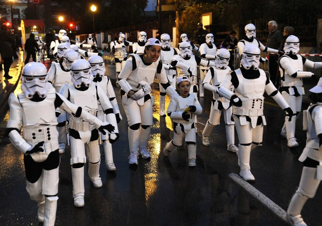 Revellers dressed as Stormtroopers participate in the parade of the Carnival in Gijon, northern Spain,  February 16, 2015. (Photo by Eloy Alonso/Reuters)