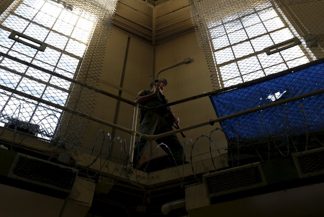 An armed guard patrols the East Block for condemned prisoners during a media tour of California's Death Row at San Quentin State Prison in San Quentin, California December 29, 2015. (Photo by Stephen Lam/Reuters)