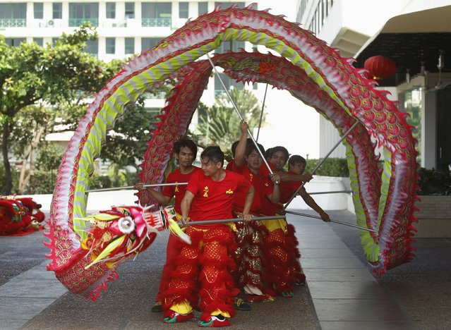 Men perform a dragon dance to celebrate the Chinese New Year in Phnom Penh February 17, 2015. (Photo by Samrang Pring/Reuters)