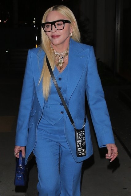 "Madonna looks chic in blue as she is spotted leaving dinner with friends at celebrity hot spot Craig's in West Hollywood on April 20, 2021. Madonna looks ageless as the 62 year old singer donned a blue 3 piece pants suit with black boots and a blue crocodile skin purse. She finished the look with a pair of trendy black glasses and necklaces around her neck. Madonna recently called gun control ""a new vaccination"" in passionate Instagram post saying, ""It will save lives"". (Photo by Backgrid USA)"