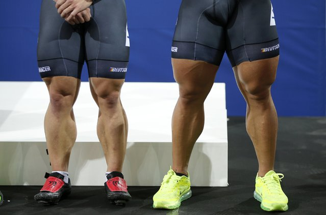 The legs of third placed German team members Rene Enders (L) and Robert Forstemann (R) are pictured during the podium ceremony in the men's team sprint race at the UCI Track Cycling World Cup in Saint-Quentin-en-Yvelines, near Paris, February 18, 2015. (Photo by Charles Platiau/Reuters)