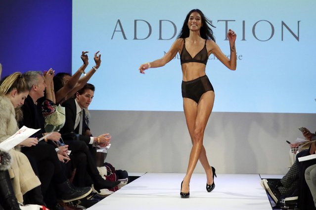 "The 2015 CURVExpo and Invista sleepwear, loungewear and swim collections are modeled during the 2nd annual Lingerie Fashion Night, ""Romancing the Runway"", in New York, Monday, February 23, 2015. (Photo by Richard Drew/AP Photo)"