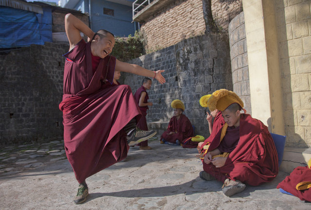 An exile Tibetan monk gestures as he makes a point in a dialectics debate with another monk, sitting right, at the Kirti monastery in Dharmsala, India, Monday, January 18, 2016. The debate is an essential part of their training as Buddhist monks. (Photo by Ashwini Bhatia/AP Photo)
