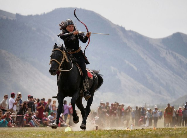 Turkey's Janset Genel in full flight during the mounted archery event, which the 18-year-old would go on to win, at the third World Nomad Games in Cholpon-Ata, Kyrgyzstan on September 9, 2018. (Photo by Amos Chapple/Radio Free Europe/Radio Liberty)