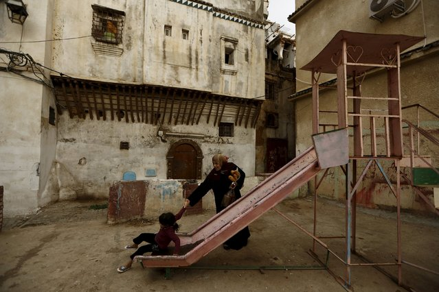 A woman helps her daughter as she plays on a slide in the old city of Algiers Al Casbah, Algeria  December 3, 2015. (Photo by Zohra Bensemra/Reuters)