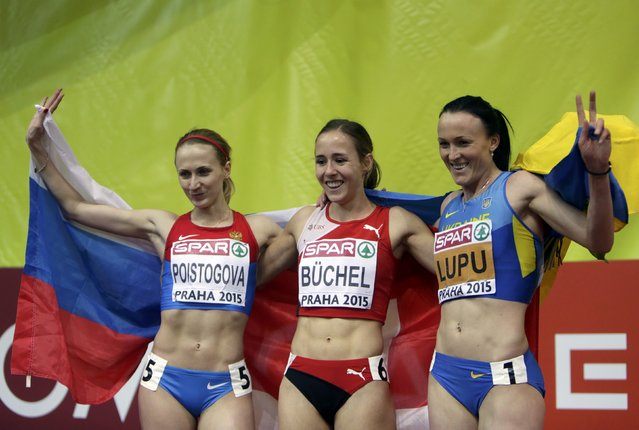 Winner Selina Buchel of Switzerland, second placed Yekaterina Poistogova of Russia (L) and third placed Nataliya Lupu of Ukraine (R) celebrate after their women's 800 metres final during the European Indoor Championships in Prague March 8, 2015. REUTERS/David W Cerny (CZECH REPUBLIC  - Tags: SPORT ATHLETICS)