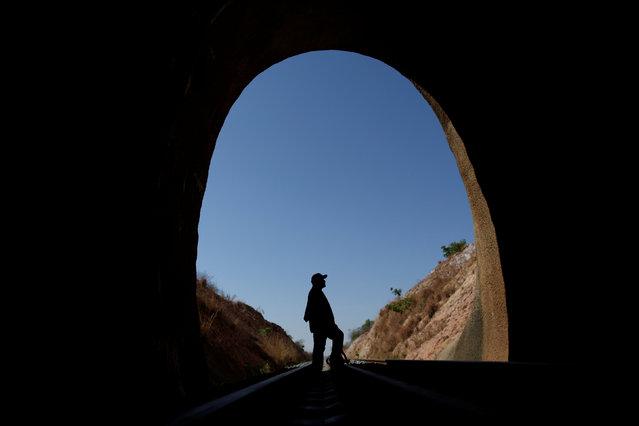 Cicero Antonio do Nascimento, rests inside a tunnel, part of the Transnordestina railway track in Brejo Santo, Ceara state, Brazil, October 29, 2016. (Photo by Ueslei Marcelino/Reuters)