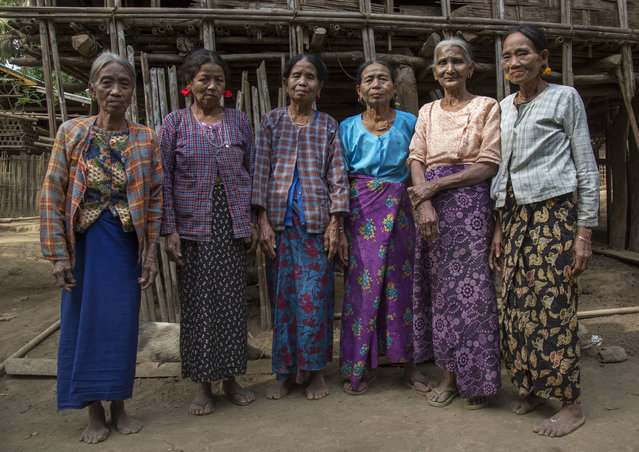 A group of woman from the Muun tribe who inhabit the hills of the Arakan state. The design, known as the letter B-pattern, is common in the Mindat area. It is composed of dots, lines and occasionally circles, in February, 2015, in Myanmar, Burma. (Photo by Eric Lafforgue/Barcroft Media)